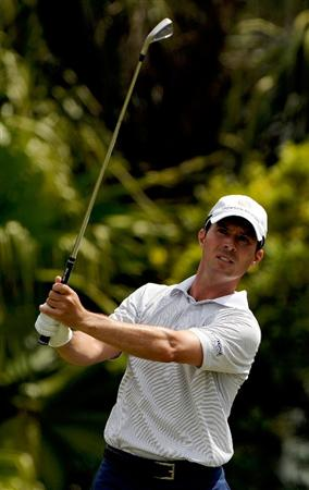 DORAL, FL - MARCH 12:  Mike Weir of Canada hits a shot during the first round of the World Golf Championships-CA Championship at the Doral Golf Resort & Spa on March 12, 2009 in Miami, Florida.  (Photo by Sam Greenwood/Getty Images)