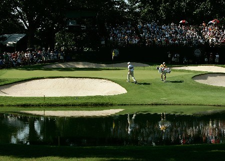 TULSA, OK - AUGUST 12:  Woody Austin walks to a green with his caddie Brent Henley during the final round of the 89th PGA Championship at the Southern Hills Country Club on August 12, 2007 in Tulsa, Oklahoma.  (Photo by Streeter Lecka/Getty Images)