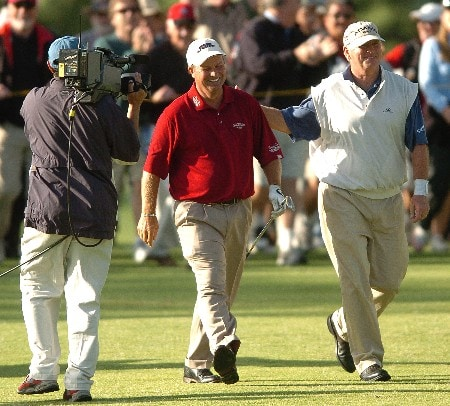 Mark Johnson is congratulated by Tom Jenkins after Johnson hit his approach shot on the 18th hole from 98 yards which he holed for an eagle and a first place finish during the second round of the Champions' Tour 2005 Toshiba Senior Classic at  the Newport Beach Country Club in Newport Beach, California March 20, 2005.