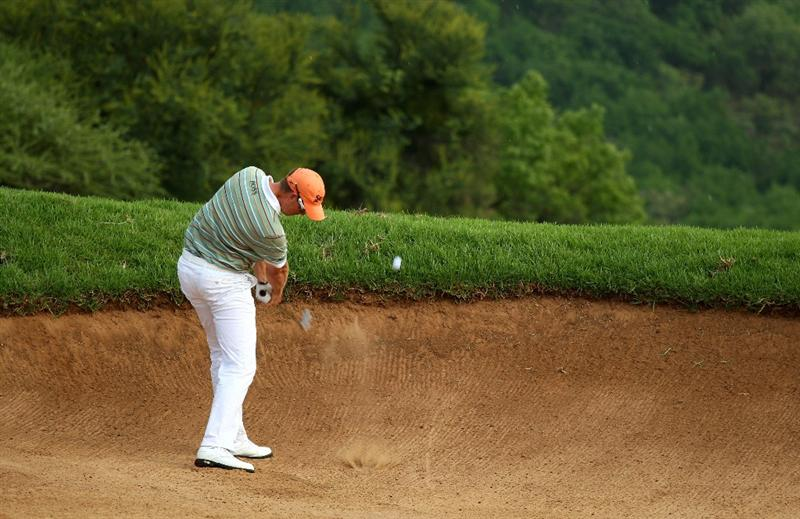 SUN CITY, SOUTH AFRICA - DECEMBER 06:  Henrik Stenson of Sweden plays from a bunker on the 15th during the third round of the Nedbank Golf Challenge at the Gary Player Country Club on December 6, 2008 in Sun City, South Africa.  (Photo by Richard Heathcote/Getty Images)