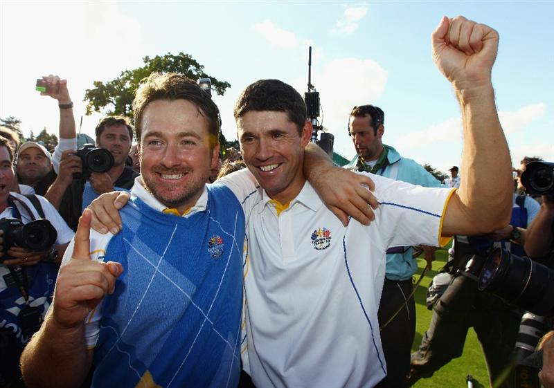 NEWPORT, WALES - OCTOBER 04:  Graeme McDowell of Europe celebrates his 3&1 win to secure victory for  the European team on the 17th green with Padraig Harrington (R) in the singles matches during the 2010 Ryder Cup at the Celtic Manor Resort on October 4, 2010 in Newport, Wales.  (Photo by Richard Heathcote/Getty Images)