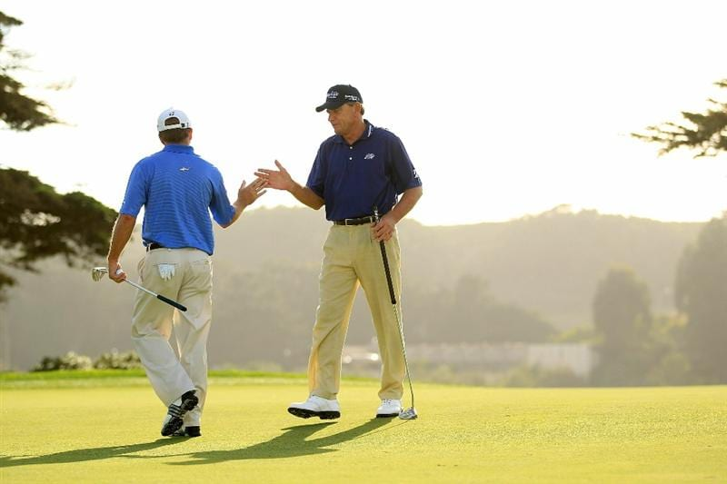 SAN FRANCISCO - NOVEMBER 04:  Nick Price high fives Fred Funk after Price made a birdy putt on the 16th hole during round 1 of the Charles Schwab Cup Championship at Harding Park Golf Course on November 4, 2010 in San Francisco, California.  (Photo by Ezra Shaw/Getty Images)