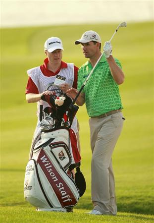 BAHRAIN, BAHRAIN - JANUARY 27:  Padraig Harrington of Ireland waits with his caddie Ronan Flood on the 17th hole during the first round of the Volvo Golf Champions at The Royal Golf Club on January 27, 2011 in Bahrain, Bahrain.  (Photo by Andrew Redington/Getty Images)