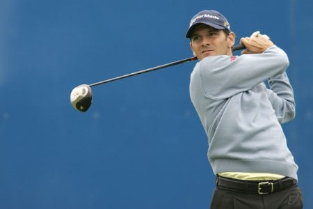 Carlos Rodiles watches his tee during the rain delayed second round of the 2005 Deutsche Bank Players Championship at Gut Kaden Golf Club in Hamburg, Germany on July 23, 2005.Photo by Pete Fontaine/WireImage.com