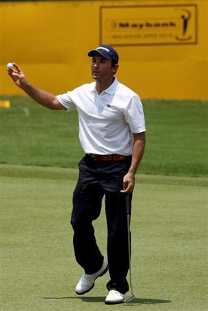 KUALA LUMPUR, MALAYSIA - MARCH 04:  Ignacio Garrido of Spain on the 18th green the first round of the Maybank Malaysia Open at the Kuala Lumpur Golf & Country on March 4, 2010 in Kuala Lumpur, Malaysia.  (Photo by Ross Kinnaird/Getty Images)