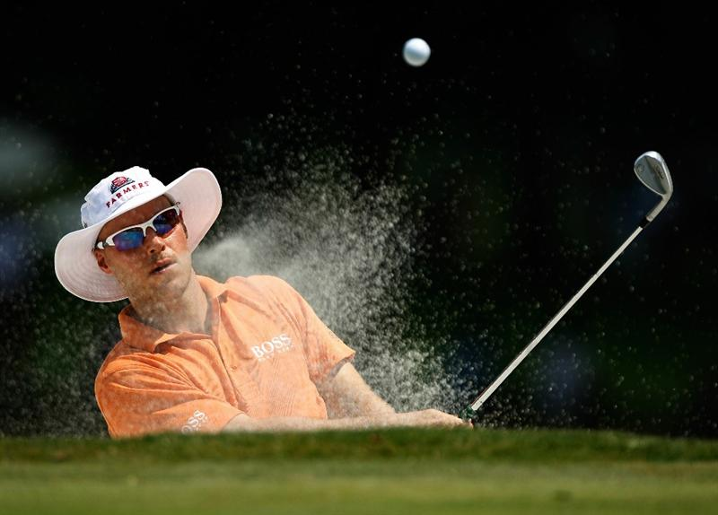 FT. WORTH, TX - MAY 30:   Ben Crane plays a bunker shot on the tenth hole during the final round of the 2010 Crowne Plaza Invitational at the Colonial Country Club on May 30, 2010 in Ft. Worth, Texas.  (Photo by Scott Halleran/Getty Images)