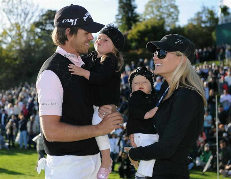 PACIFIC PALISADES, CA - FEBRUARY 20:  Aaron Baddeley of Australia is congratulated by his wife  Richelle Baddeley and children Jewell and Jolee after the final round of the Northern Trust Open at Riviera Country Club on February 20, 2011 in Pacific Palisades, California.  (Photo by Stuart Franklin/Getty Images)