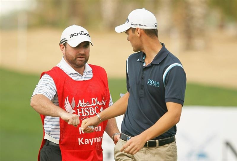 ABU DHABI, UNITED ARAB EMIRATES - JANUARY 22:  Martin Kaymer of Germany celebrates a birdie on the third hole with his caddie Craig Connelly during the third round of the 2011 Abu Dhabi HSBC Golf Championship at the Abu Dhabi Golf Club on January 22, 2011 in Abu Dhabi, United Arab Emirates.  (Photo by Scott Halleran/Getty Images)
