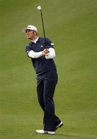ICHEON, SOUTH KOREA - APRIL 29:  Dustin Johnson of the USA hits his second shot on the 12th hole during the second round of the Ballantine's Championship at Blackstone Golf Club on April 29, 2011 in Icheon, South Korea.  (Photo by Andrew Redington/Getty Images)