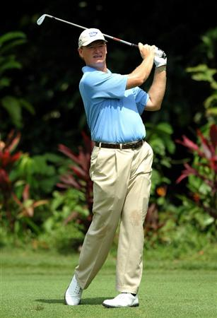 KUALA LUMPUR, MALAYSIA - OCTOBER 28: Ernie Els of South Africa watches his 2nd shot on the 1st tee during day one of the CIMB Asia Pacific Classic at The MINES Resort & Golf Club on October 28, 2010 in Kuala Lumpur, Malaysia. (Photo by Stanley Chou/Getty Images)