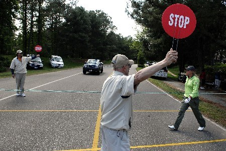 WILLIAMSBURG, VA - MAY 13:  Course marshals stop traffic for Suzann Pettersen of Norway (R) to walk to the 15th tee in the Final Round of the LPGA Michelob ULTRA Open at Kingsmill May 13, 2007 in Williamsburg, Virginia.  (Photo by Jonathan Ernst/Getty Images)