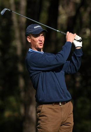 PEBBLE BEACH, CA - FEBRUARY 13: Indianapolis Colts quarterback Peyton Manning hits his tee shot on the 11th hole at Poppy Hills Golf Course during the second round of the the AT&T Pebble Beach National Pro-Am on February 13, 2009 in Pebble Beach, California. (Photo by Stephen Dunn/Getty Images)