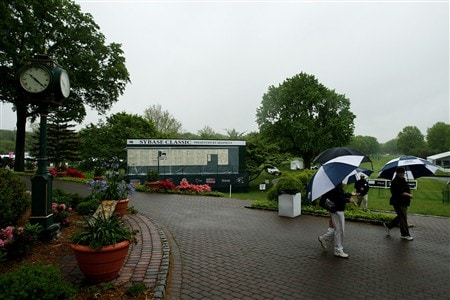 CLIFTON, NJ - MAY 16:  Patrons walk by under umbrellas shortly before play being suspended due to rain early in the second round of the Sybase Classic presented by ShopRite on May 16, 2008 at the Upper Montclair Country Club in Clifton, New Jersey.  (Photo by Travis Lindquist/Getty Images)