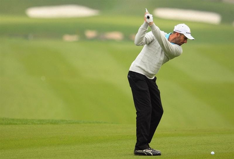 SHANGHAI, CHINA - NOVEMBER 10:  Geoff Ogilvy of Australia hits his second shot on the eighth hole during the final round of the HSBC Champions at Sheshan Golf Club on November 10, 2008 in Shanghai, China.  (Photo by Scott Halleran/Getty Images)