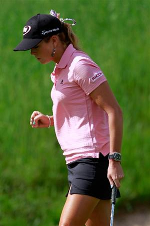 GLADSTONE, NJ - MAY 20:  Paula Creamer reacts after a birdie on the eighteenth hole to defeat Karrie Webb of Australia in round two of the Sybase Match Play Championship at Hamilton Farm Golf Club on May 20, 2011 in Gladstone, New Jersey.  (Photo by Chris Trotman/Getty Images)