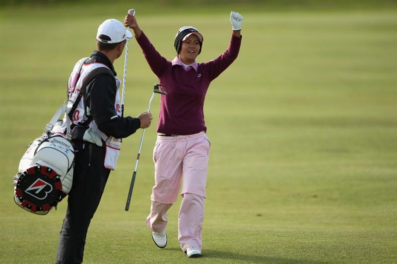LYTHAM ST ANNES, ENGLAND - JULY 30:  Ai Miiyazato of Japan celebrates a good approach shot on the 4th hole during the first round of the 2009 Ricoh Women's British Open Championship held at Royal Lytham St Annes Golf Club, on July 30, 2009 in  Lytham St Annes, England.  (Photo by Warren Little/Getty Images)