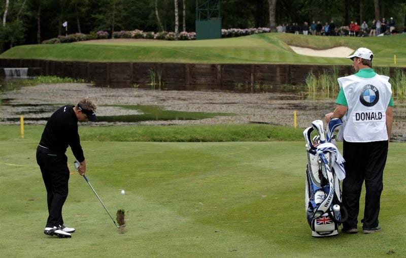 VIRGINIA WATER, ENGLAND - MAY 28:  Luke Donald of England hits his approach on the 8th hole during the third round of the BMW PGA Championship at the Wentworth Club on May 28, 2011 in Virginia Water, England.  (Photo by David Cannon/Getty Images)