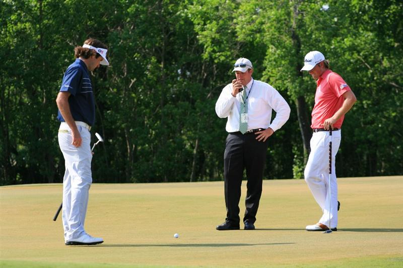 NEW ORLEANS, LA - MAY 1: Webb Simpson speaks with a rules official on the 15th green after Simpson's ball moved during the final round of the Zurich Classic at the TPC Louisiana on May 1, 2011 in New Orleans, Louisiana. (Photo by Hunter Martin/Getty Images)