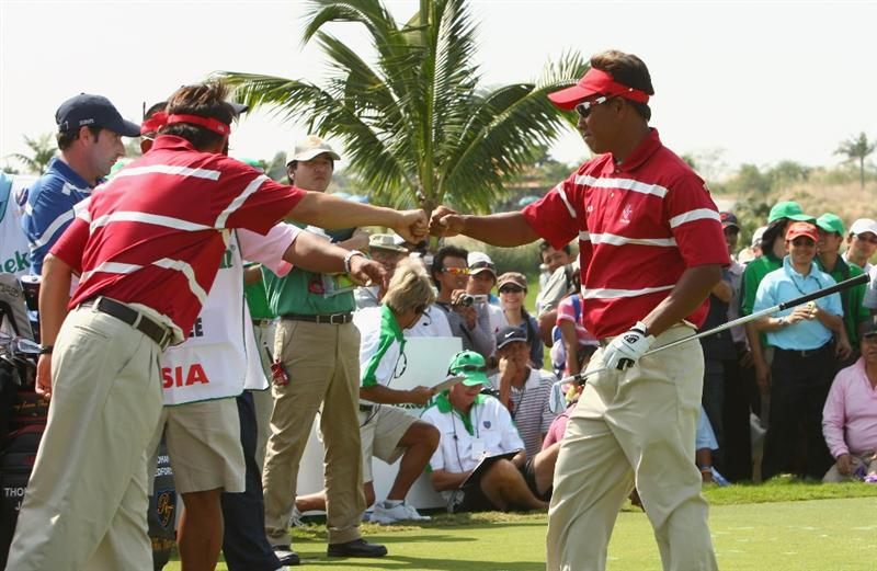 BANGKOK, THAILAND - JANUARY 09:  Asian Team Captain Naomochi ?Joe? Ozak celebrates with Thongchai Jaidee of Thailand during Day one of The Royal Trophy at the Amata Spring Country Club on January 8, 2009 in Bangkok, Thailand.  (Photo by Ian Walton/Getty Images)