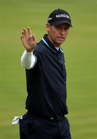 VIRGINIA WATER, ENGLAND - MAY 27:  Anders Hansen of Denmark acknowledges the crowd on the 18th green during the second round of the BMW PGA Championship at the Wentworth Club on May 27, 2011 in Virginia Water, England.  (Photo by Warren Little/Getty Images)