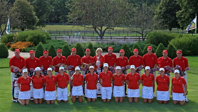SUGAR GROVE, IL - AUGUST 18:  The USA team (left to right) Morgan Pressel, Christina Kim, Kristy McPherson, Brittany Laing, Natalie Gulbis, Juli Inkster, Beth Daniel (Captain), Michelle Wie, Paula Creamer, Brittany Lincicome, Nicole Castrale, Angela Stanford, Cristie Kerr with their caddies during the official team photocall as a preview for the 2009 Solheim Cup Matches, at the Rich Harvest Farms Golf Club on August 18, 2009 in Sugar Grove, Ilinois  (Photo by David Cannon/Getty Images)