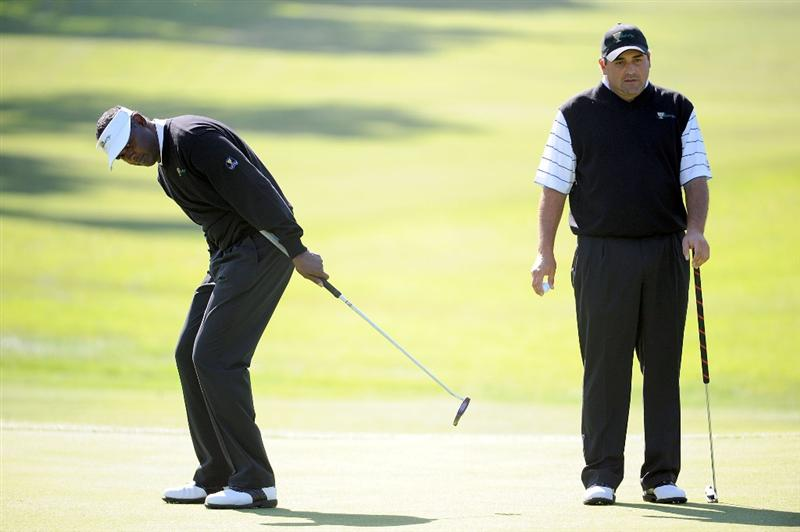 SAN FRANCISCO - OCTOBER 07:  Vijay Singh (L) and Angel Cabrera of the International Team putt during a practice round prior to the start of The Presidents Cup at Harding Park Golf Course on October 7, 2009 in San Francisco, California.  (Photo by Harry How/Getty Images)