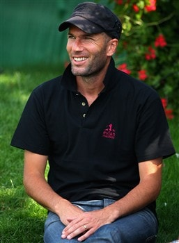 EVIAN, FRANCE - JULY 27:  French football Zinedine Zidane watches the play on the 18th green during the final round of the Evian Masters at the Evian Masters Golf Club on July 27, 2008 in Evian, France.  (Photo by Andrew Redington/Getty Images)