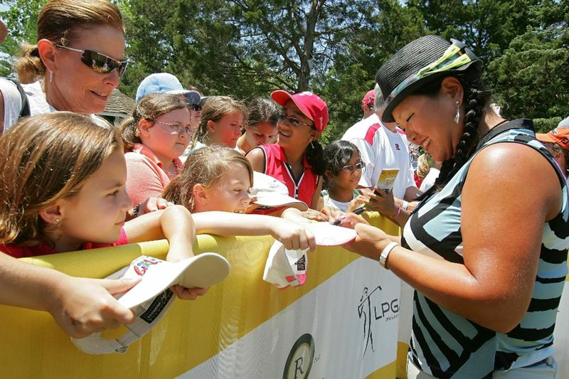GALLOWAY, NJ - JUNE 19: Christina Kim signs autographs for fans during the second round of the ShopRite LPGA Classic held at Dolce Seaview Resort (Bay Course) on June 19, 2010 in Galloway, New Jersey.  (Photo by Michael Cohen/Getty Images)