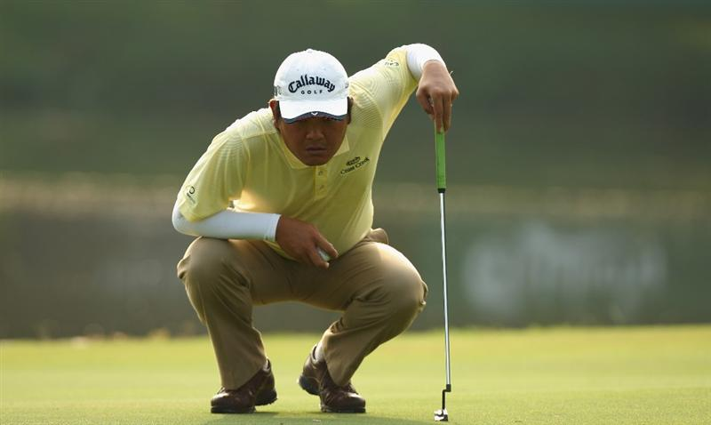 KUALA LUMPUR, MALAYSIA - FEBRUARY 13:  Danny Chia of Malaysia lines up a put on the 16th green during the round two of the 2009 Maybank Malaysian Open at Saujana Golf and Country Club on February 13, 2009 in Kuala Lumpur, Malaysia.  (Photo by Ian Walton/Getty Images)