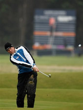 ST ANDREWS, SCOTLAND - OCTOBER 10:  Robert Karlsson of Sweden chips onto the third green during the final round of The Alfred Dunhill Links Championship at The Old Course on October 10, 2010 in St Andrews, Scotland.  (Photo by Ross Kinnaird/Getty Images).