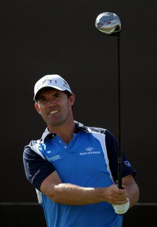 DUBAI, UNITED ARAB EMIRATES - NOVEMBER 21:  Padraig Harrington of Ireland plays his tee shot at the 7th hole during the third round of the Dubai World Championship, on the Earth Course, Jumeirah Golf Estates on November 21, 2009 in Dubai, United Arab Emirates  (Photo by David Cannon/Getty Images)