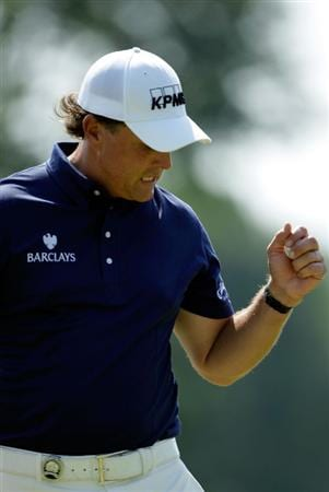 CHASKA, MN - AUGUST 14:  Phil Mickelson walks off a green during the second round of the 91st PGA Championship at Hazeltine National Golf Club on August 14, 2009 in Chaska, Minnesota.  (Photo by Jamie Squire/Getty Images)