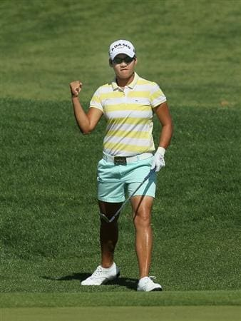 RANCHO MIRAGE, CA - APRIL 4:   Yani Tseng of Taiwan pumps her fist after chipping for an eagle on the dsecond hole during the final round of the Kraft Nabisco Championship at Mission Hills Country Club on April 4, 2010 in Rancho Mirage, California.  (Photo by Stephen Dunn/Getty Images)