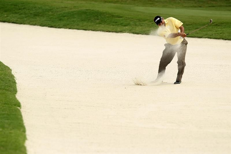 PONTE VEDRA BEACH, FL - MAY 14:  Angel Cabrera of Argentina hits from a bunker on the 11th hole during the third round of THE PLAYERS Championship held at THE PLAYERS Stadium course at TPC Sawgrass on May 14, 2011 in Ponte Vedra Beach, Florida.  (Photo by Scott Halleran/Getty Images)