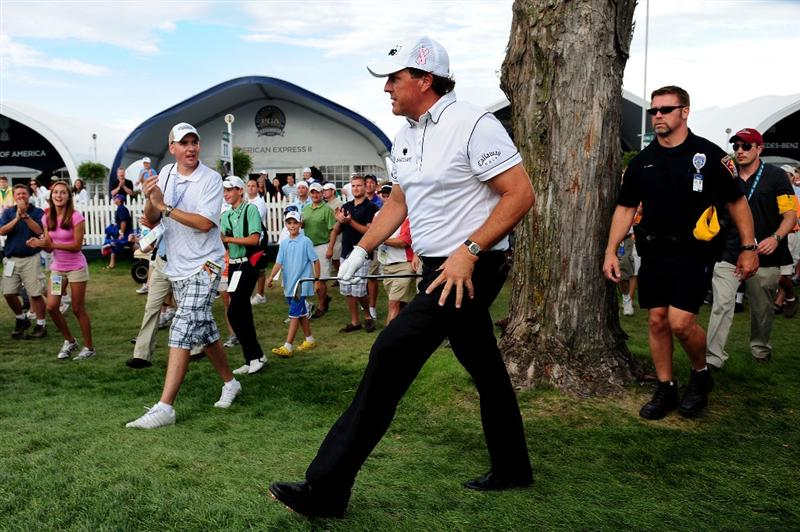 CHASKA, MN - AUGUST 13:  Phil Mickelson watches a shot from the rough on the 18th hole during the first round of the 91st PGA Championship at Hazeltine National Golf Club on August 13, 2009 in Chaska, Minnesota.  (Photo by Stuart Franklin/Getty Images)
