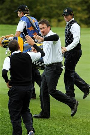 NEWPORT, WALES - OCTOBER 03:  Rory McIlroy of Europe and team mate Graeme McDowell are congratulated by Vice Captain Sergio Garcia during the  Fourball & Foursome Matches during the 2010 Ryder Cup at the Celtic Manor Resort on October 3, 2010 in Newport, Wales.  (Photo by Jamie Squire/Getty Images)