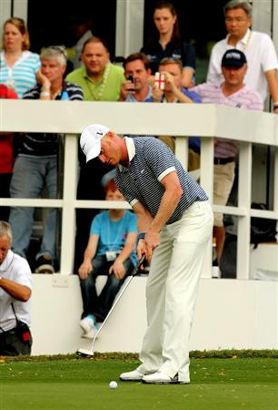 HONG KONG - NOVEMBER 20:  Simon Dyson of England putts during day three of the UBS Hong Kong Open at The Hong Kong Golf Club on November 20, 2010 in Hong Kong, Hong Kong.  (Photo by Stanley Chou/Getty Images)