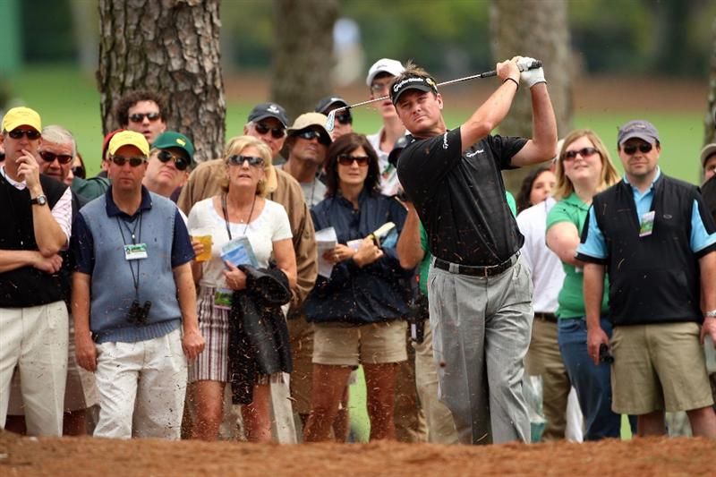 AUGUSTA, GA - APRIL 11:  Todd Hamilton hits a shot from the pine needles on the first hole during the third round of the 2009 Masters Tournament at Augusta National Golf Club on April 11, 2009 in Augusta, Georgia.  (Photo by Andrew Redington/Getty Images)