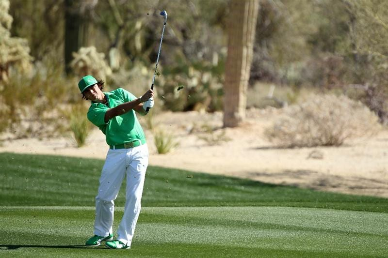 MARANA, AZ - FEBRUARY 23:  Rickie Fowler hits an approach shot on the second hole during the first round of the Accenture Match Play Championship at the Ritz-Carlton Golf Club on February 23, 2011 in Marana, Arizona.  (Photo by Andy Lyons/Getty Images)