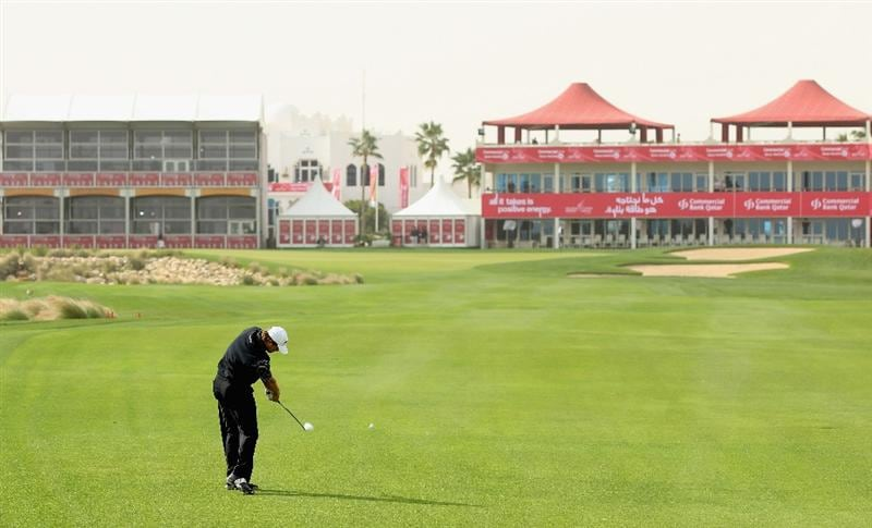 DOHA, QATAR - FEBRUARY 03:  Retief Goosen of South Africa hits his second shot on the 18th hole during the first round of the Commercialbank Qatar Masters held at Doha Golf Club on February 3, 2011 in Doha, Qatar.  (Photo by Andrew Redington/Getty Images)