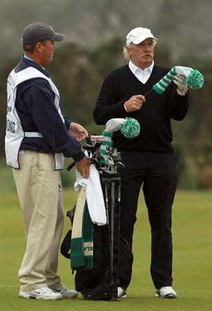 CARNOUSTIE, SCOTLAND - OCTOBER 09:  Irish businessman Dermot Desmond with his caddie on the 12th hole during the third round of The Alfred Dunhill Links Championship at the Carnoustie Golf Links on October 9, 2010 in Carnoustie, Scotland.  (Photo by Andrew Redington/Getty Images)