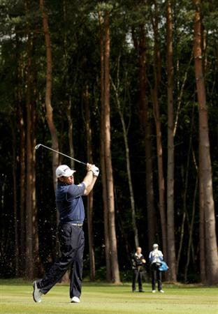 VIRGINIA WATER, ENGLAND - MAY 29:  Lee Westwood of England hits his 2nd shot on the 12th hole during the final round of the BMW PGA Championship  at the Wentworth Club on May 29, 2011 in Virginia Water, England.  (Photo by Ross Kinnaird/Getty Images)