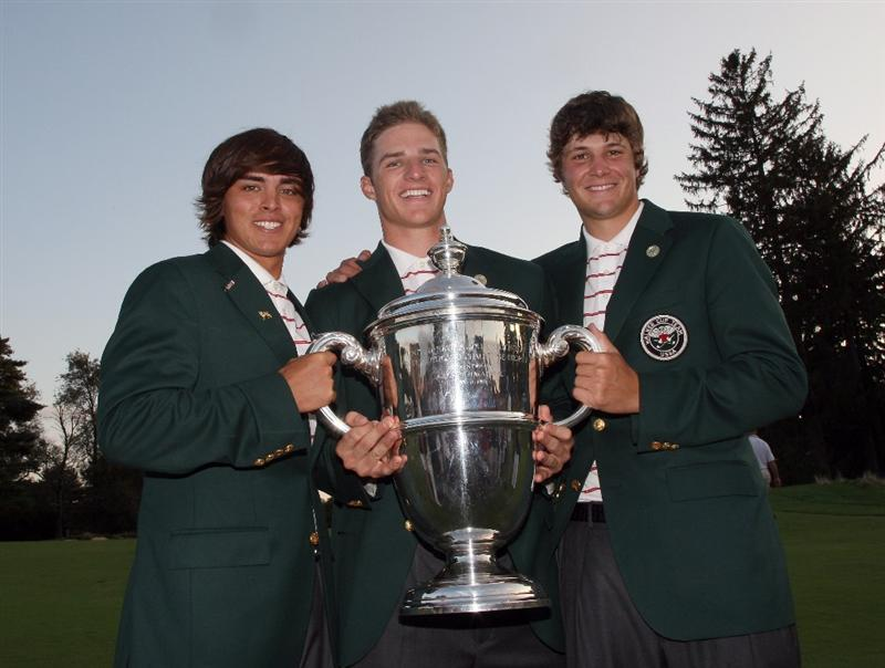 ARDMORE, PA - SEPTEMBER 13:  Rickie Fowler, Morgan Hoffman and Peter Uihlein of the USA with the trophy after the USA had won the match, all are members of the Oklahoma State University Golf Team after the final afternoon singles matches on the East Course at Merion Golf Club on September 13, 2009 in Ardmore, Pennsylvania  (Photo by David Cannon/Getty Images)