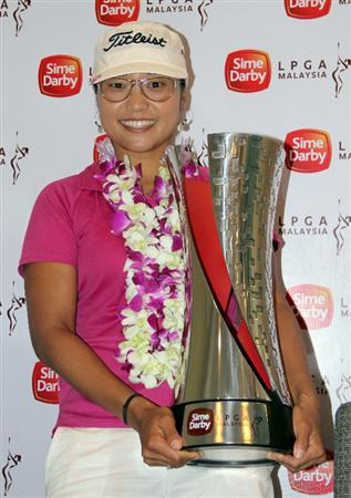 KUALA LUMPUR, MALAYSIA - OCTOBER 24:  Jimin Kang of USA poses with the Sime Darby LPGA Trophy after the final round of the Sime Darby LPGA on October 24, 2010 at the Kuala Lumpur Golf and Country Club in Kuala Lumpur, Malaysia. (Photo by Stanley Chou/Getty Images)