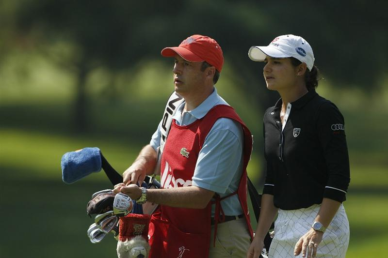 GUADALAJARA, MEXICO - NOVEMBER 11: Lorena Ochoa of Mexico (R) walks with her husband and caddie, Andres Conesa, the CEO of Aeromexico during the first round of the Lorena Ochoa Invitational Presented by Banamex and Corona Light at Guadalajara Country Club on November 11, 2010 in Guadalajara, Mexico.  (Photo by Michael Cohen/Getty Images)