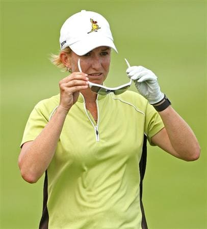SINGAPORE - FEBRUARY 26:  Karrie Webb of Australia adjusts her sunglasses on the 18th hole during the second round of the HSBC Women's Champions at the Tanah Merah Country Club on February 26, 2010 in Singapore.  (Photo by Andrew Redington/Getty Images)