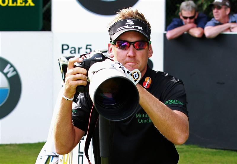 VIRGINIA WATER, ENGLAND - MAY 25:  Ian Poulter of England tries his hand at photography during the Pro-Am round prior to the BMW PGA Championship at Wentworth Club on May 25, 2011 in Virginia Water, England.  (Photo by Andrew Redington/Getty Images)
