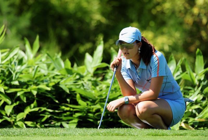 EVIAN-LES-BAINS, FRANCE - JULY 25:  Michelle Wie of USA lines up a putt during the third round of the Evian Masters at the Evian Masters Golf Club on July 25, 2009 in Evian-les-Bains, France.  (Photo by Stuart Franklin/Getty Images)