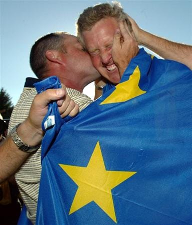 BLOOMFIELD TOWNSHIP, MI - SEPTEMBER 19:  European team player Colin Montgomerie of Scotland celebrates with his teammates and caddies after a 1up victory over USA team player David Toms during their Sunday singles match at the 35th Ryder Cup Matches at the Oakland Hills Country Club on September 19, 2004 in Bloomfield Township, Michigan.. (Photo by Jamie Squire/Getty Images)