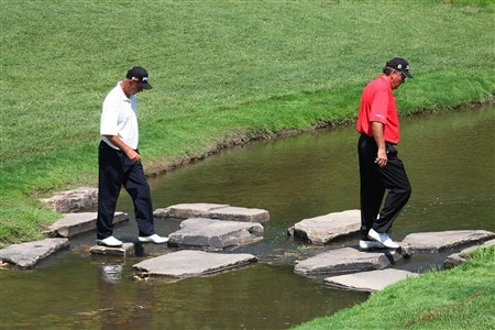WEST DES MOINES, IA - MAY 30:  Keith Fergus and Mark James cross over stones to the 17th green during the first round of the Principal Charity Classic on May 30, 2008 at Glen Oaks Country Club in West Des Moines, Iowa. (Photo by G. Newman Lowrance/Getty Images)